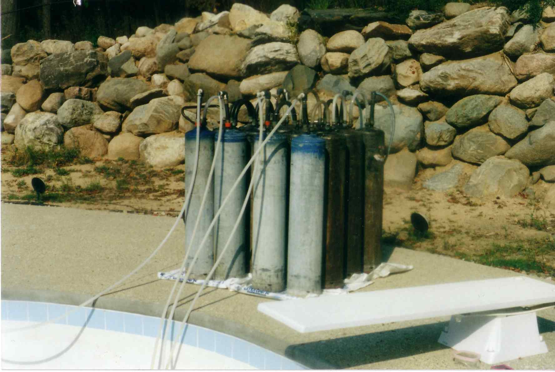 Iron removing tanks for pools